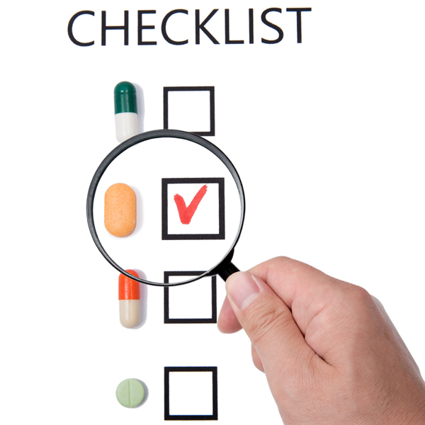 Checklist on white paper with Magnifier