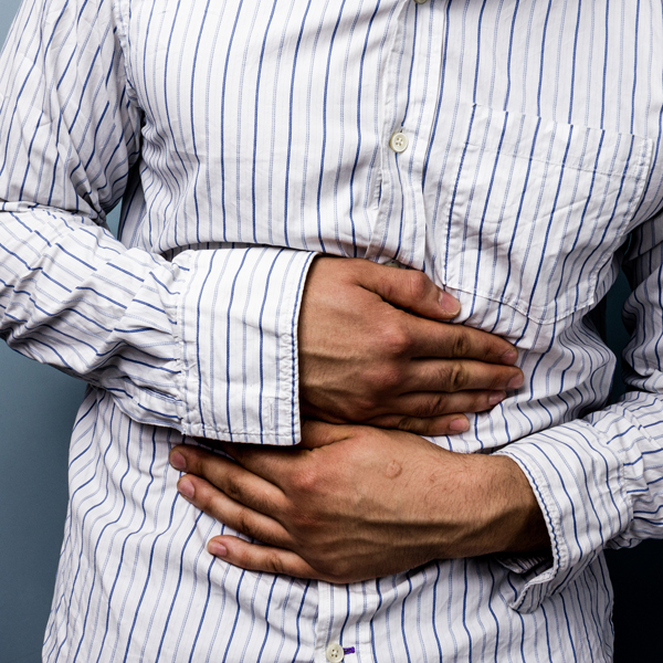 Multiracial man with stomach pains