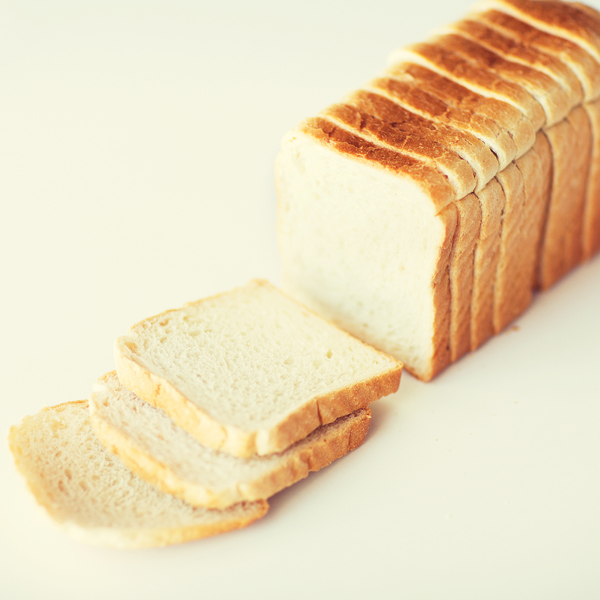 close up of white sliced toast bread on table